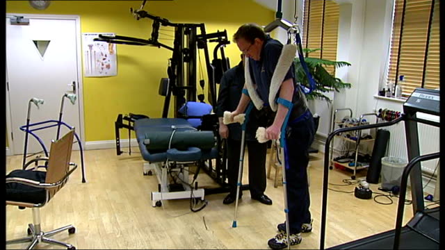 paralysed man learns to walk again england london marylebone int guy harris taking small steps using crutches and sling for support hratch ogali... - waist stock videos & royalty-free footage