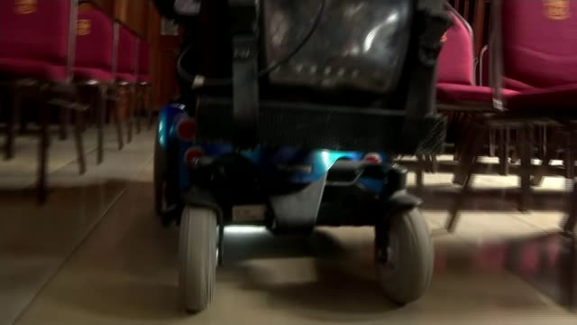 paralysed student earns first class honours degree england bristol bristol university int various of student robb camm along in wheelchair he was... - bristol university stock videos and b-roll footage