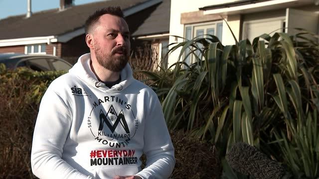 paralysed survivor of manchester arena bombing to climb mount kilimanjaro; england: manchester: ext martin hibbert setup and interview sot - natural landmark stock videos & royalty-free footage