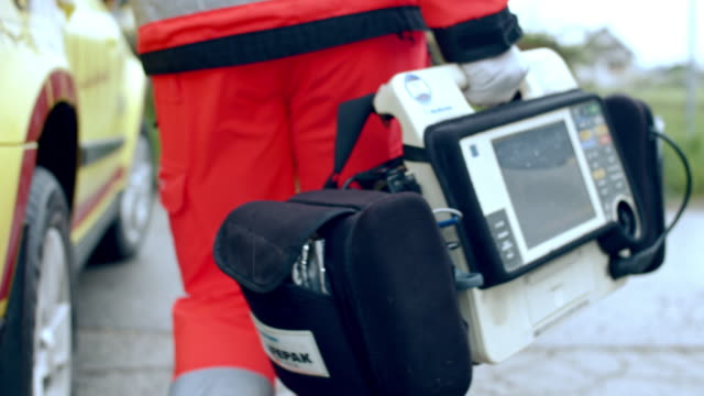 ms paramedic carrying a portable defibrillator - paramedic stock videos & royalty-free footage