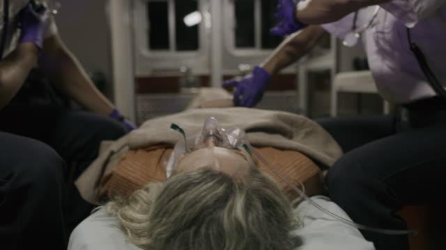 vidéos et rushes de paramedic checking pulse of patient in ambulance / lehi, utah, united states - lehi