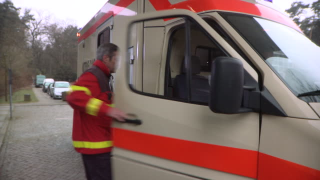 MS Paramedic getting into ambulance / Berlin, Germany