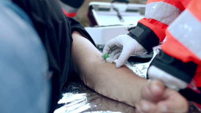 ms paramedic injecting a medicine to a patient - cpr stock videos & royalty-free footage