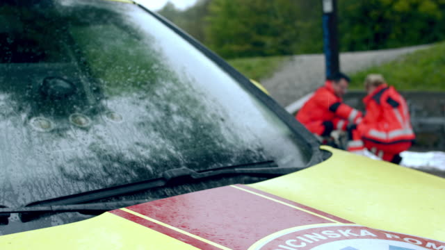 ws paramedic team attempts to resuscitate a patient - roadside stock videos & royalty-free footage