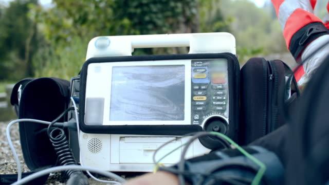 ms paramedic team checking ekg monitor - cpr stock videos & royalty-free footage