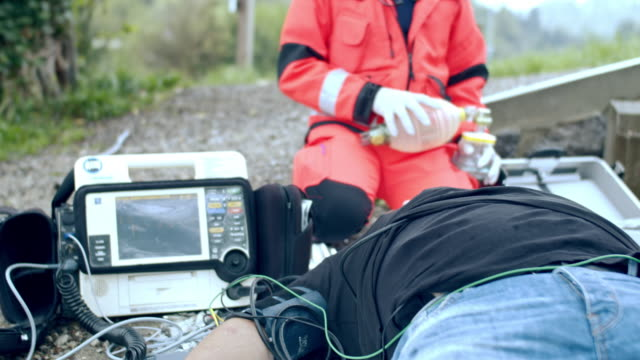 ms paramedic team performing a cpr - defibrillator stock videos & royalty-free footage