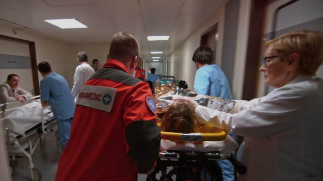 ds paramedic team transporting a child suffering from hypothermia to the er - stretcher stock videos & royalty-free footage