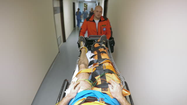 pov paramedic transporting a patient on the stretcher to the emergency room - injured stock videos & royalty-free footage