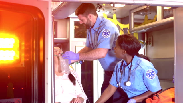 paramedics care for patient inside ambulance - comforting colleague stock videos & royalty-free footage