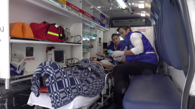 Paramedics in an ambulance with a patient