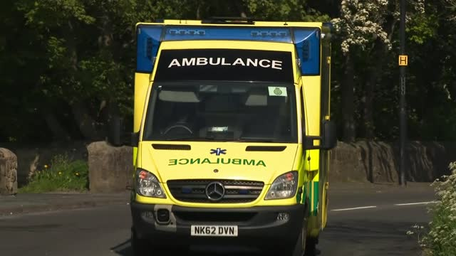 paramedics in england to wear body cameras in bid to reduce attacks on frontline workers; england: ext ambulance from gateway and along road - gate stock videos & royalty-free footage