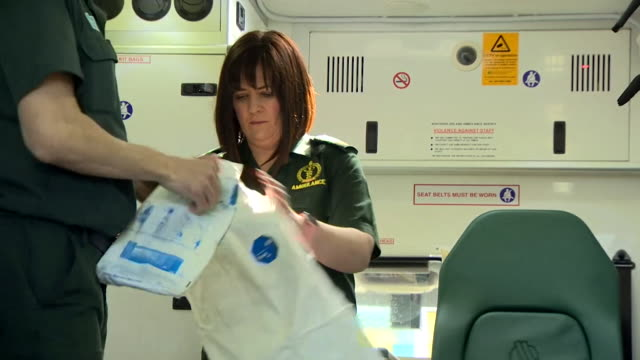 paramedics in northern ireland putting on full ppe in their ambulance due to the coronavirus pandemic - ambulance stock videos & royalty-free footage