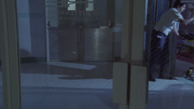paramedics pushing a gurney in a hospital. - hospital trolley stock videos & royalty-free footage
