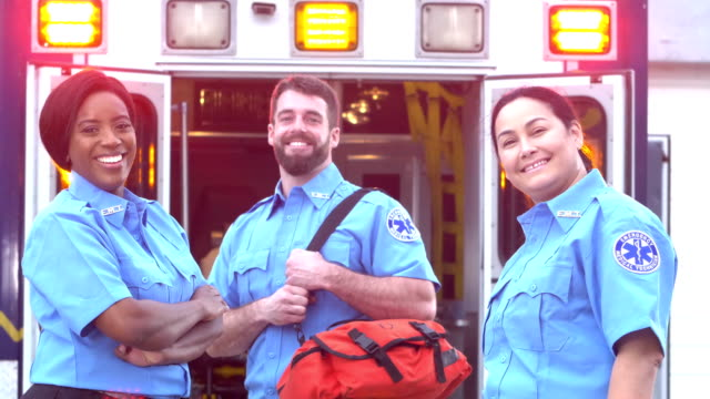 paramedics standing in front of ambulance - career stock videos & royalty-free footage