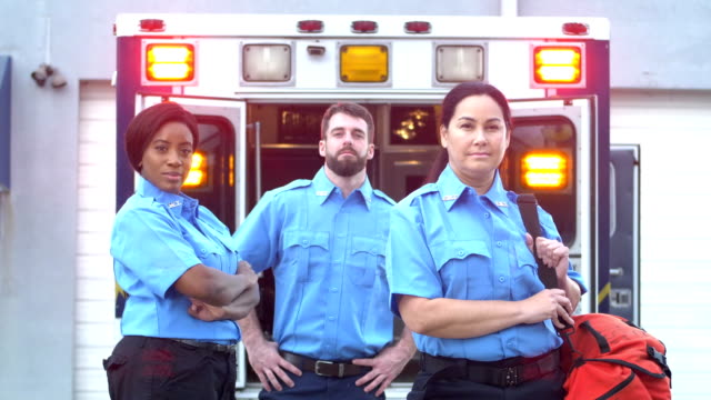 paramedics standing in front of ambulance - rescue worker stock videos & royalty-free footage