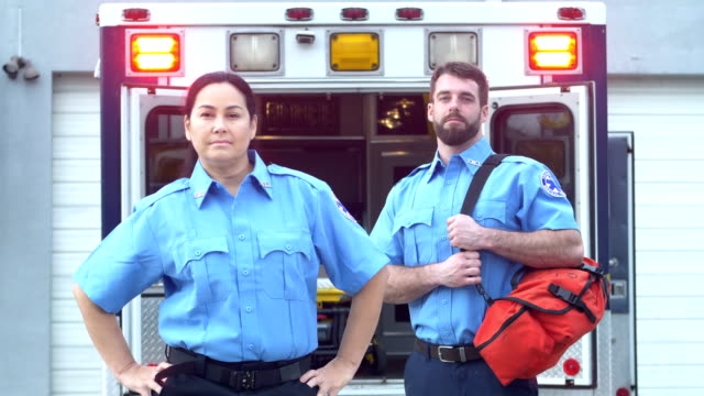 paramedics standing in front of ambulance - rescue services occupation stock videos & royalty-free footage