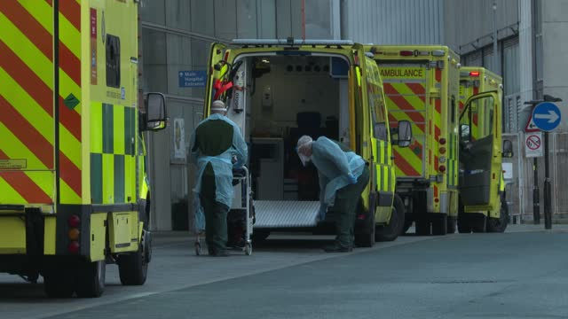 paramedics wearing full ppe transfer l patient, as a line of ambulances outside the royal london hospital in east london on january 3, 2021. - the... - shape stock videos & royalty-free footage