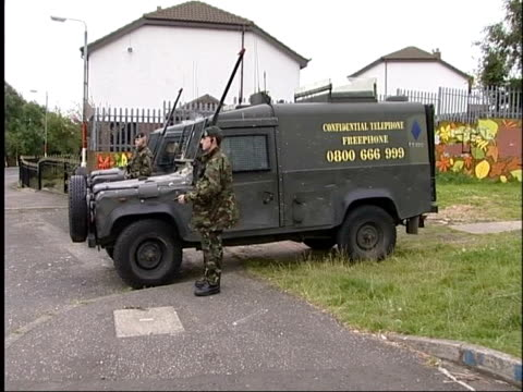 paramilitary ceasefires; republic of ireland: ulster: ext side soldiers standing guard next armoured vehicles soldier holding rifle rifle butt as... - ceasefire stock videos & royalty-free footage