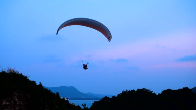 paramotor flying in the air - paragliding stock videos & royalty-free footage