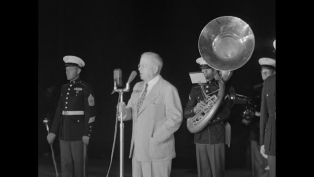 Paramount Pictures Corporation VPresident Y Frank Freeman steps to microphone in front of Marine Band / SOT ñGratified that all of us in the industry...