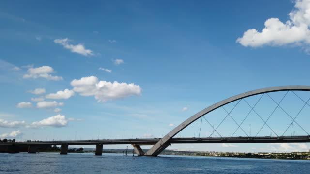 paranoa lake with the famous jk bridge on background. - juscelino kubitschek bridge stock videos & royalty-free footage