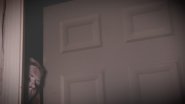 paranormal at the door - peeking stock videos & royalty-free footage