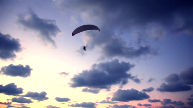 paraplane in the sky before a sunset - skydiving stock videos & royalty-free footage