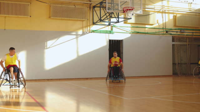 paraplegic athletes playing basketball together - paraplegic stock videos & royalty-free footage