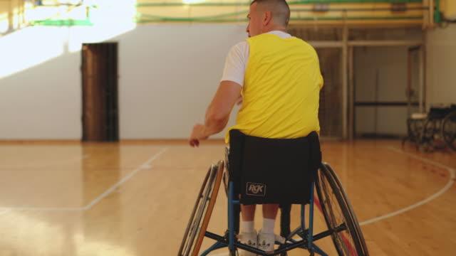 paraplegic basketball players preparing for the match - paraplegic stock videos & royalty-free footage