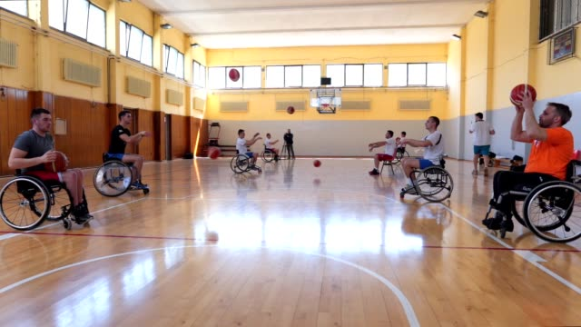 paraplegic basketball training together passing the ball - wheelchair basketball stock videos & royalty-free footage