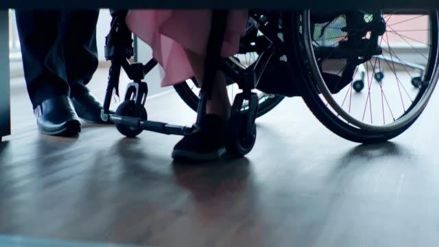 paraplegic businesswoman in wheelchair working at desk in office - paraplegic stock videos & royalty-free footage