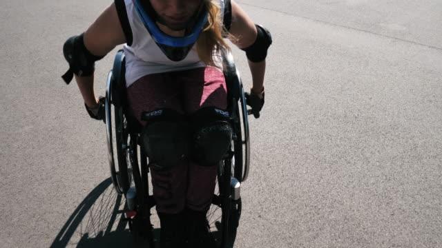 paraplegic gen-z woman in wheelchair in skate park - paraplegic stock videos & royalty-free footage