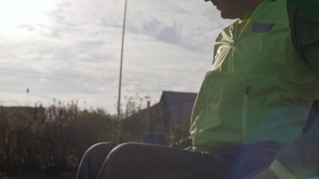 paraplegic man playing basketball on wheelchair - wheelchair basketball stock videos and b-roll footage