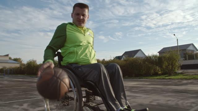 paraplegic man skillfully dribbling basketball - paraplegic stock videos & royalty-free footage