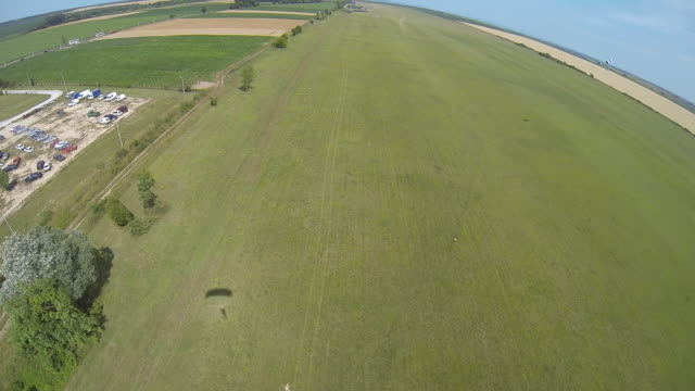 Parasailer lands in agricultural field