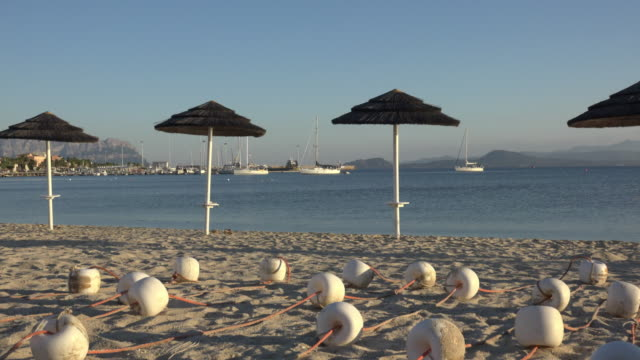 zo / parasol on beach of golfo aranci - sassari stock videos & royalty-free footage