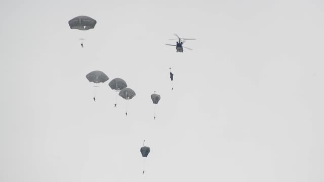 us paratroopers and multinational partners from spain germany and the united kingdom conduct an airborne operation from a ch47 chinook helicopter at... - parachute stock videos & royalty-free footage