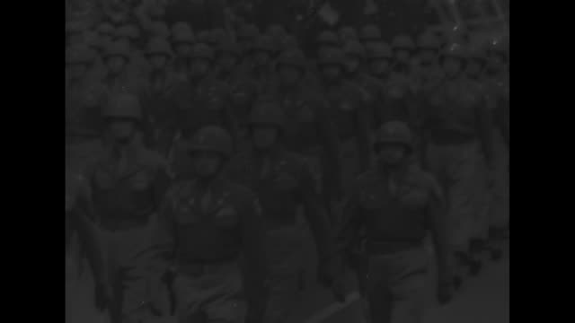 paratroopers marching in formation down street, band marching behind them during victory parade after world war ii / two shots of paratroopers... - 1946 stock videos & royalty-free footage