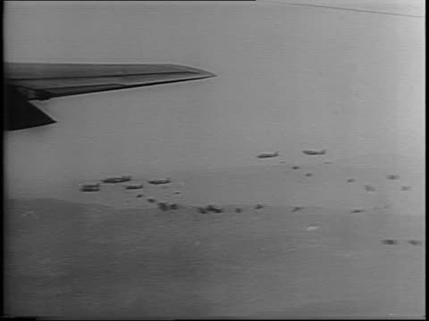 paratroopers on a c47 checks his pistol paratroopers jumping out of planes over france for invasion / paratroopers marching after having landed... - fallschirmjäger stock-videos und b-roll-filmmaterial