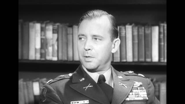 paratroopers parachuting down dissolving into us army capt. carl zimmerman speaking to camera, camera pulls out to reveal us army lt. col. robert b... - 国防省点の映像素材/bロール
