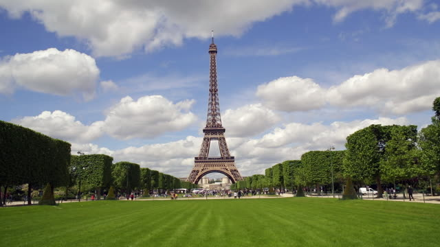 parc du champ de mars, eiffel tower, paris, france - eiffel tower paris stock videos & royalty-free footage