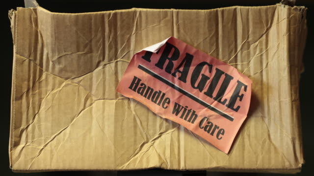 parcel damaged in the post with fragile sign on it - fragility stock videos & royalty-free footage