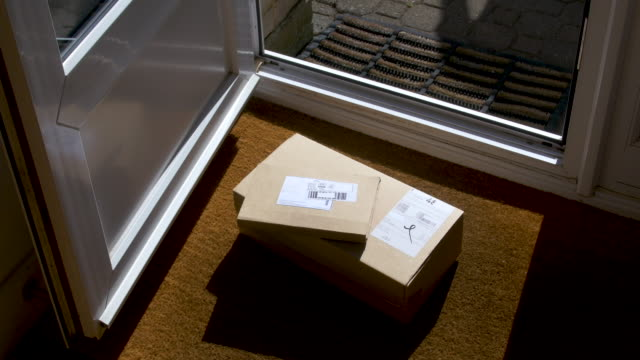 parcels being delivered to front door of house. - doorstep stock videos & royalty-free footage