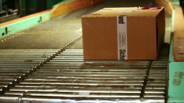 CU Parcels Loaded onto Conveyor Belt in a Parcel Distribution Center