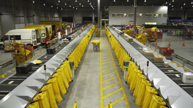 T/L WS HA Parcels on conveyer being sorted into mail bags, Auckland, New Zealand