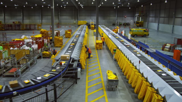 WS HA Parcels on conveyer being sorted into mail bags, Auckland, New Zealand