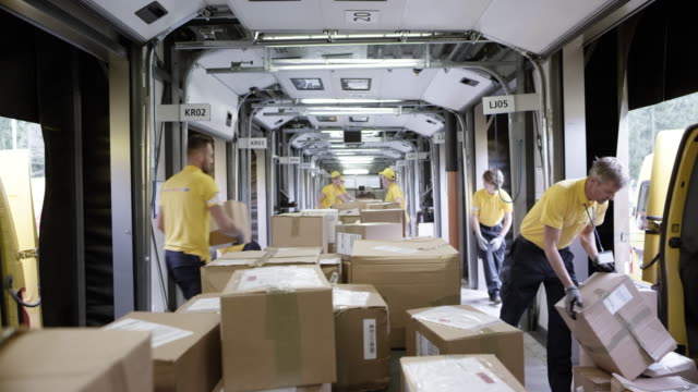 time-lapse pov parcels travelling on the sorting conveyor belt - organisation stock videos & royalty-free footage