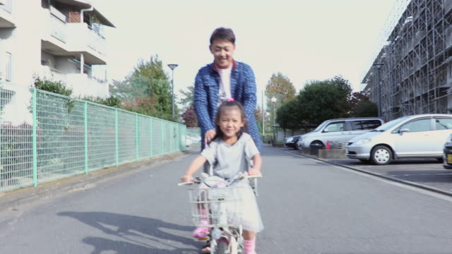Parent and child that the practice of bicycle