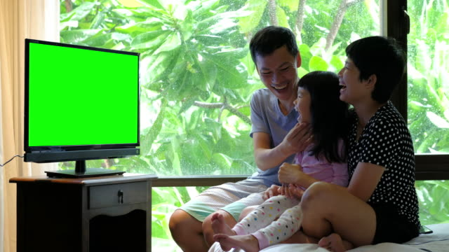 parent and daughter watch chromakey tv - family watching tv stock videos and b-roll footage