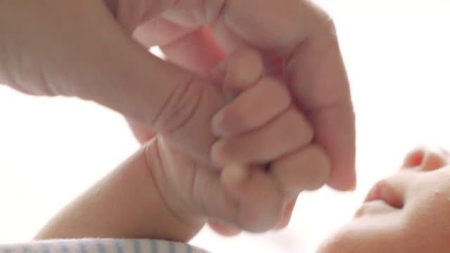 parent holding baby hands - contact lens case stock videos and b-roll footage
